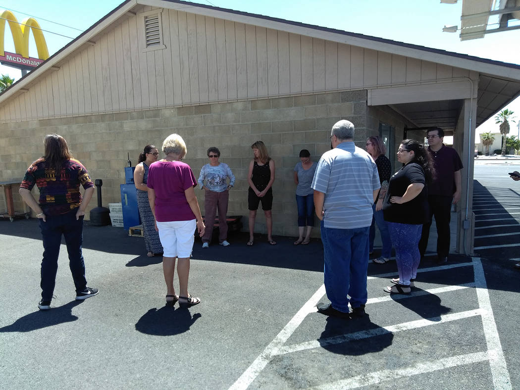 Selwyn Harris/Pahrump Valley Times Pahrump Valley Times staff prepare to join hands and observe a moment of silence for the five people killed at a Maryland newspaper office on Thursday June 28. T ...