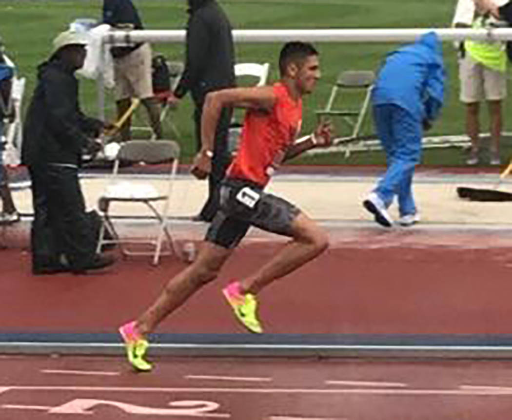 Special to the Pahrump Valley Times Jose Granados of Beatty High School and the Vegas Valley Track Club competes in the 1,500 meters at the USA Track and Field Hershey National Junior Olympics Cha ...