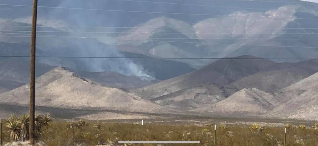 Ryan Muccio/Special to the Pahrump Valley Times A lightning fire burns in Trout Canyon on Saturday, an area that sits between Mountain Springs and Pahrump, north of Highway 160. Just over 30 acres ...