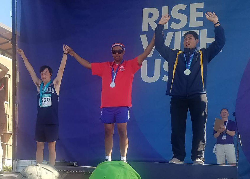 Teresa Klem/Special to the Pahrump Valley Times Billy Klem of Pahrump on the medal stand after his fifth-place finish in the 200 meters at the Special Olympics USA Games in Seattle.