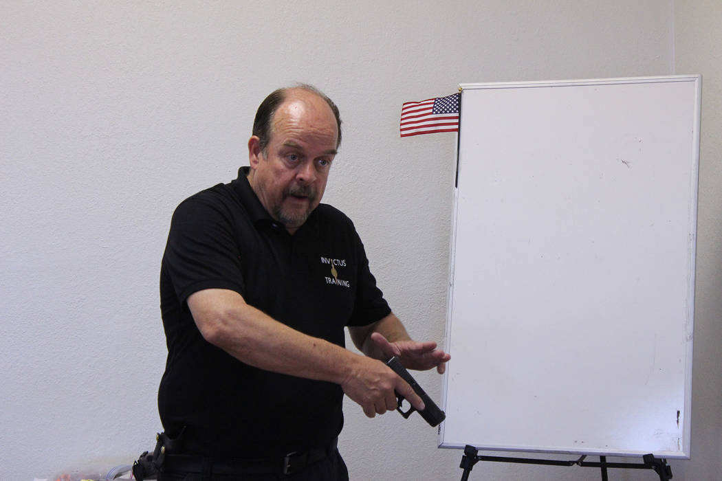 Jeffrey Meehan/Pahrump Valley Times Chuck Burnett teaches area residents during a firearms course on June 23, 2018. Burnett, along with his wife, own and operate Invictus Training, which offers fi ...