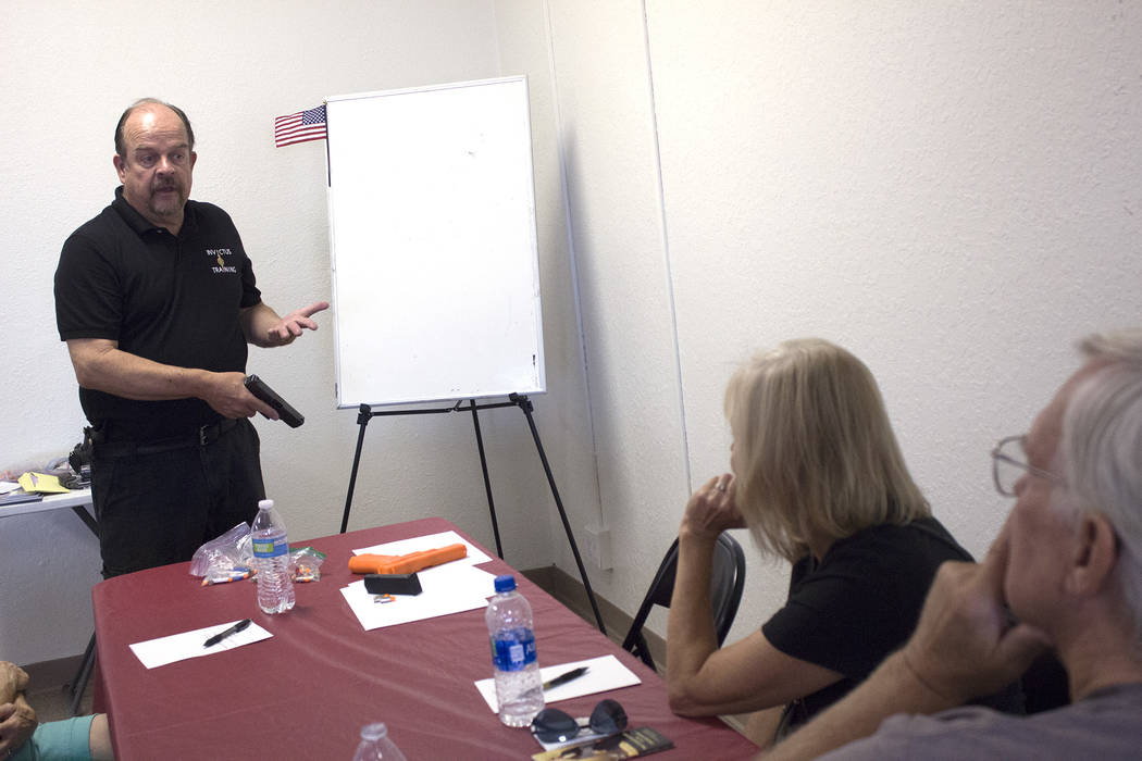 Jeffrey Meehan/Pahrump Valley Times Area residents listen during a firearms training course at Invictus Training at 921 S. Highway 160, Suite 404, on June 23, 2018. Invictus held a grand opening c ...