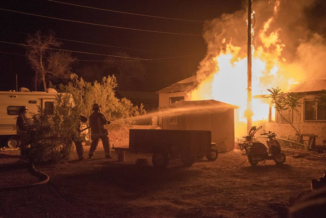 Richard Stephens/Special to the Pahrump Valley Times Beatty Volunteer Fire Department personnel were called away from their July Fourth fireworks display for a house fire at a single-wide mobile h ...