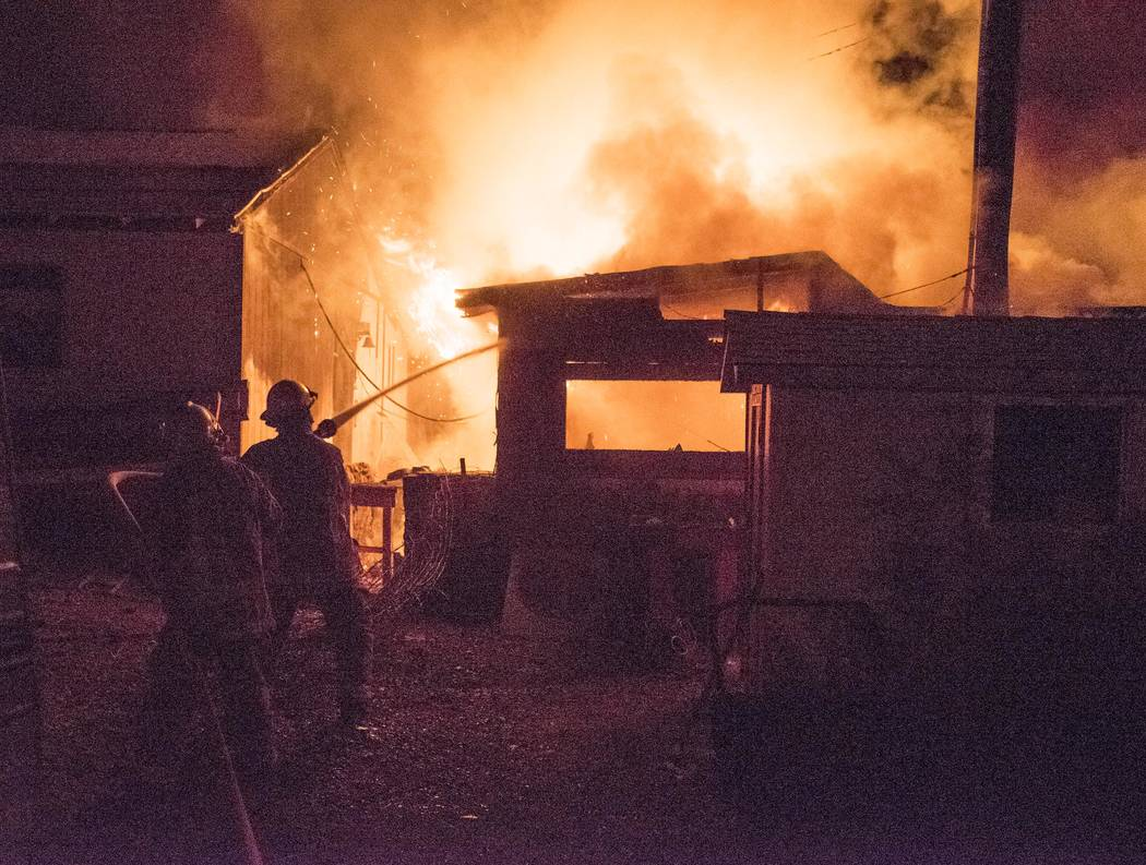 Richard Stephens/Special to the Pahrump Times An add-on room in a single-wide mobile home at 106 West Montgomery was fully engulfed when the first fire crew arrived on the scene, The home itself d ...