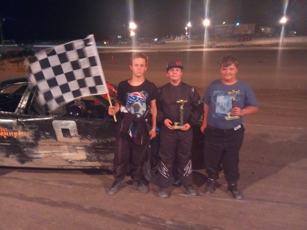 Dale Geissler/Pahrump Valley Times From left, first-place finisher Brandon Jones, second-place RJ Smotherman and third place Aiden Murphy after the Mini Stock main event July 7 at Pahrump Valley S ...