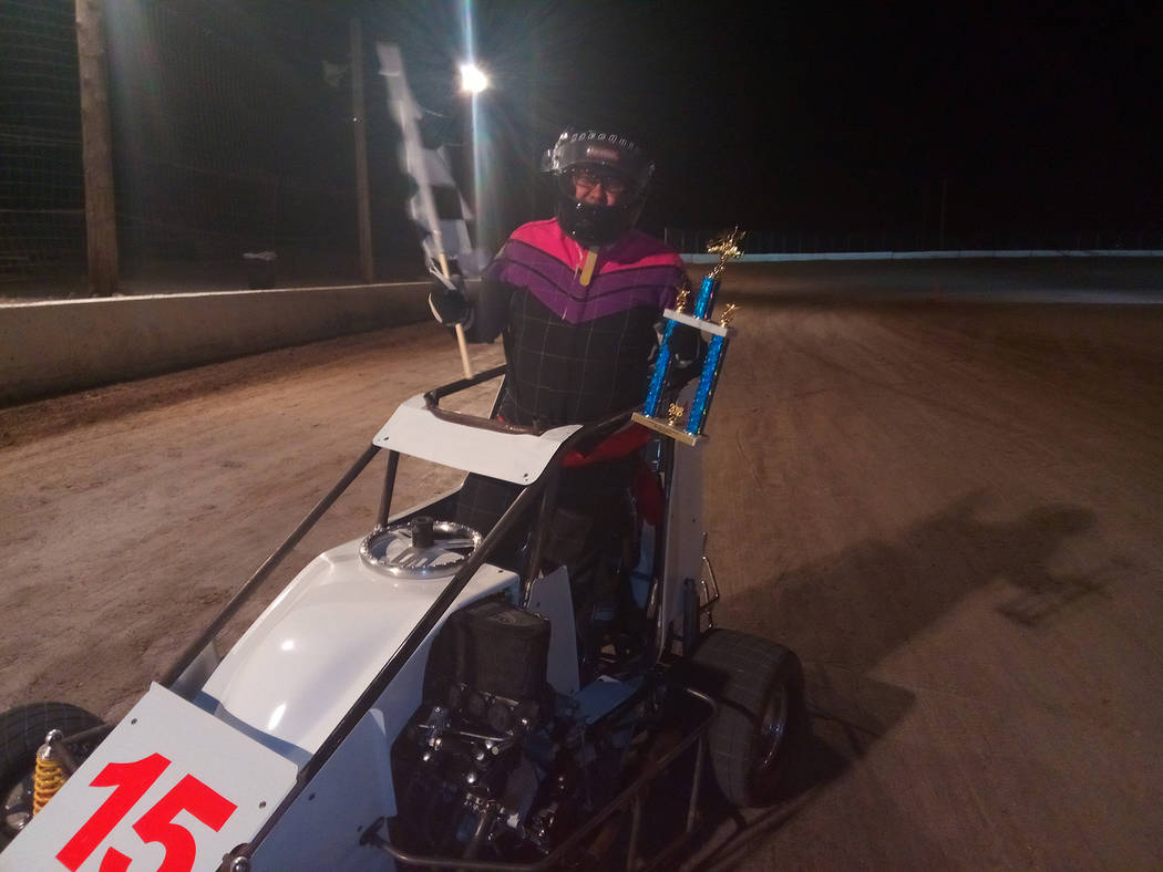 Dale Geissler/Pahrump Valley Times Clint Silva celebrates his July 7 victory in the Micro Sprint main event at Pahrump Valley Speedway.