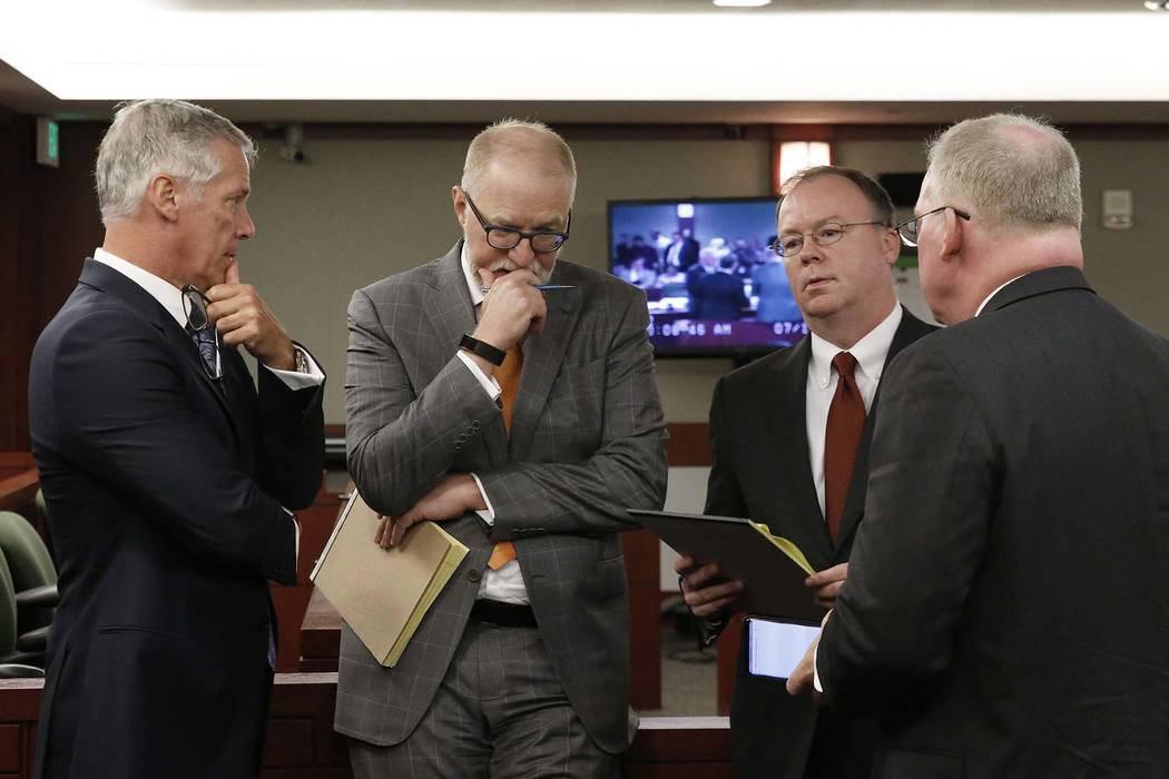Attorneys James Pisanelli, left, Todd Bice, Kenneth Schuler and Michael Faris, representing drug manufacturer Alvogen, appear at the Regional Justice Center during a hearing on Wednesday, July 11, ...