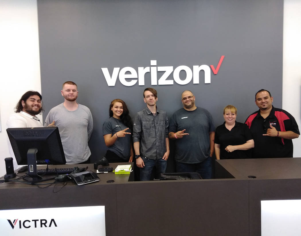Selwyn Harris/Pahrump Valley Times Verizon District Sales Manager for Nevada Mitchell Muna, far right, and staff is hosting a grand opening for the store's new location at 200 S. Highway 160, suit ...