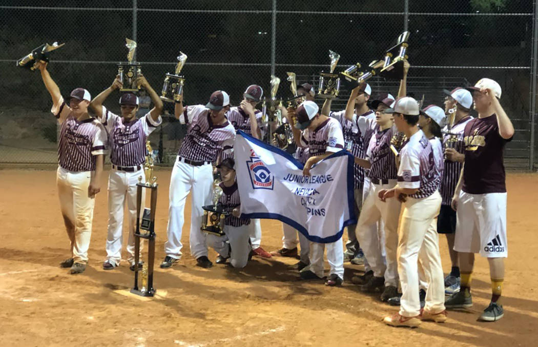 Tom Rysinski/Pahrump Valley Times The P-Town Little League Junior All-Stars display their championship banner Wednesday night at Mountain Ridge Park in Las Vegas.