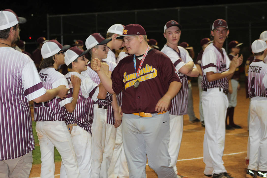 Tom Rysinski/Pahrump Valley Times Wearing his second-place medal, Summerlin North's Wes Petty congratulates Pahrump players after Wednesday night's championship game in Las Vegas.