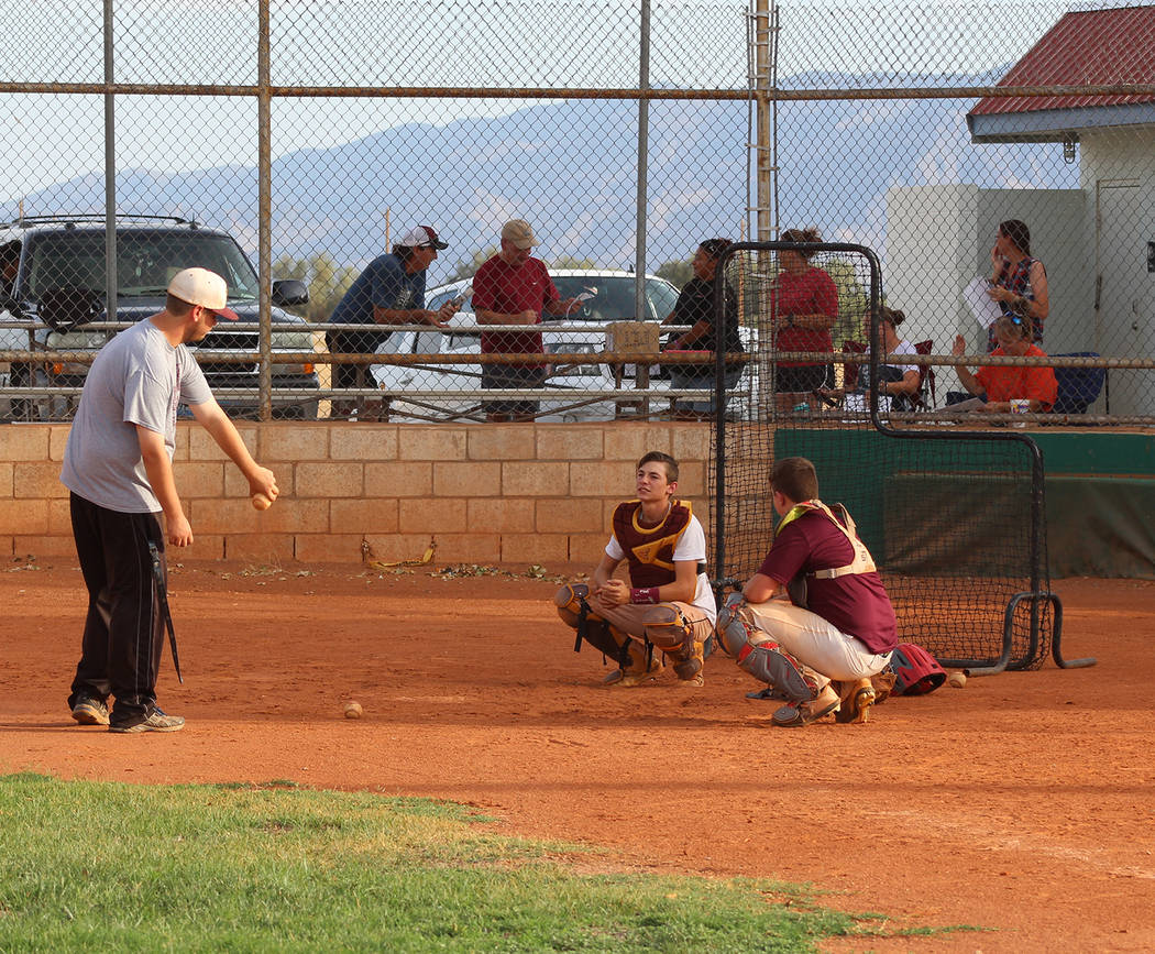 Tom Rysinski/Pahrump Valley Times Catchers do a drill with manager Drew Middleton during P-Town Little League Junior All-Stars practice while parents discuss the logistics of the trip to Reno for ...