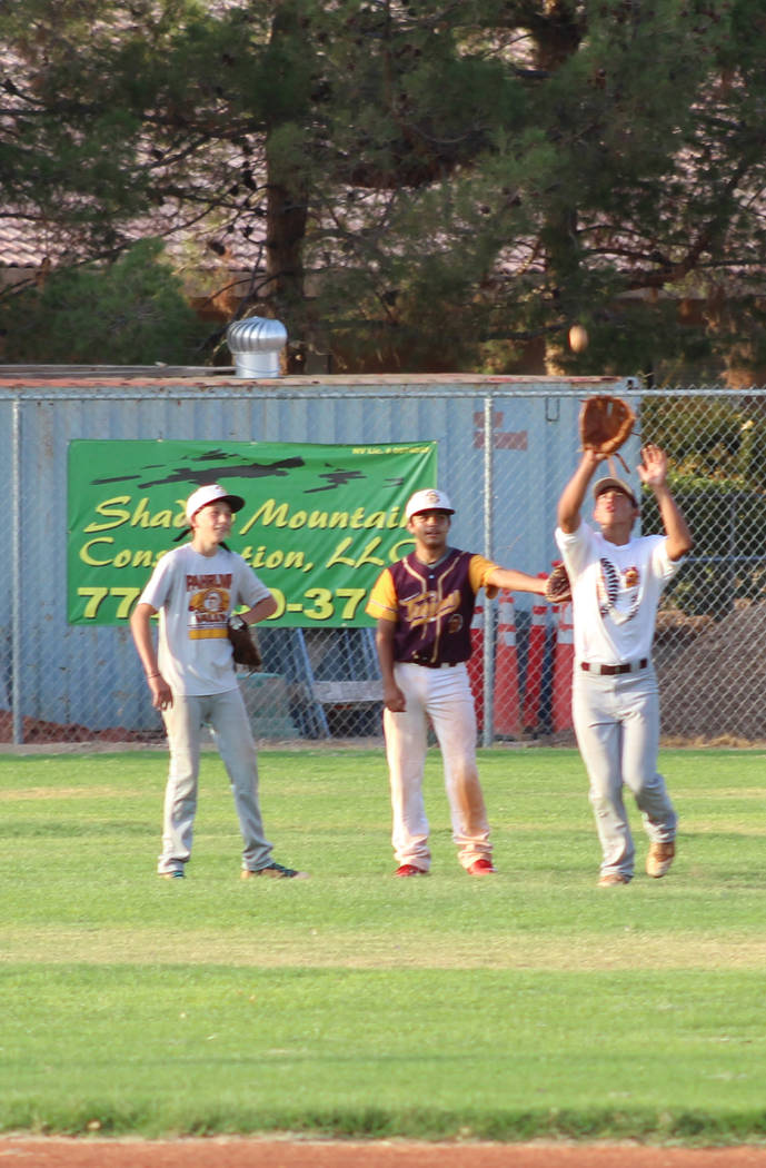 Tom Rysinski/Pahrump Valley Times P-Town Little League Junior All-Star outfielders at practice Friday night at Ian Deutch Memorial Park in Pahrump.