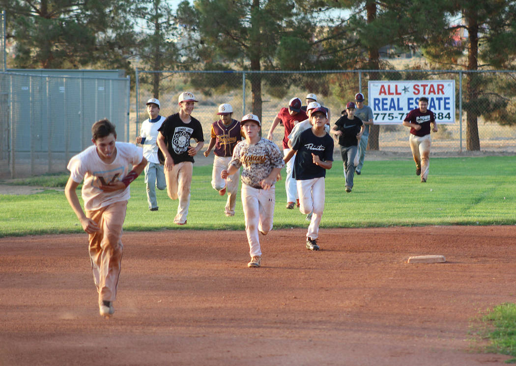 Tom Rysinski/Pahrump Valley Times Players put in a little extra running during P-Town Little League Junior All-Stars practice Friday night in Pahrump.