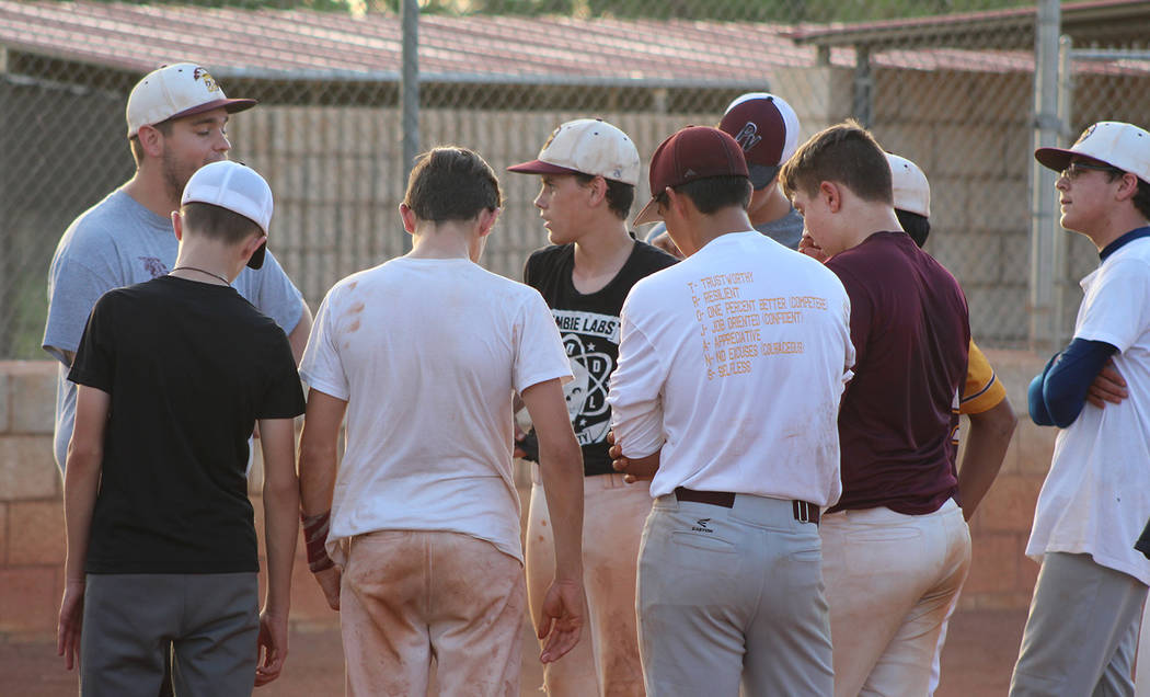 Tom Rysinski/Pahrump Valley Times P-Town Little League Junior All-Star manager Drew Middleton gets a few points across to his players during a break in practice Friday night at Ian Deutch Park in ...