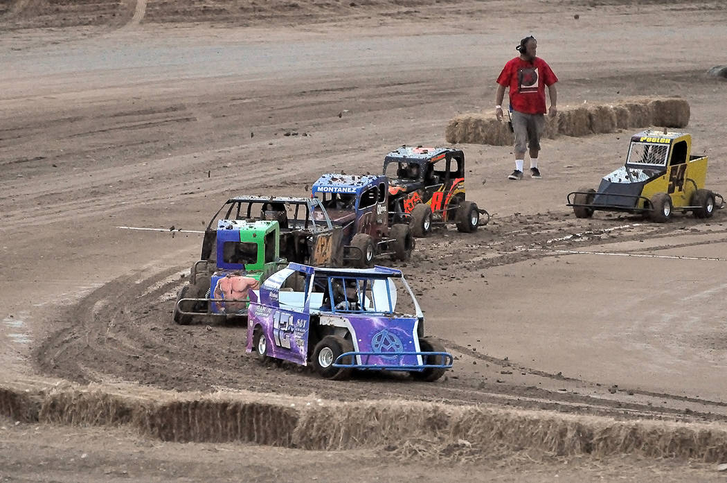 Horace Langford Jr./Pahrump Valley Times Addy Murphy, driving Thunder Girl, leads the pack during Southern Nevada Mini Dwarf racing Saturday night at Pahrump Valley Speedway. Murphy finished secon ...