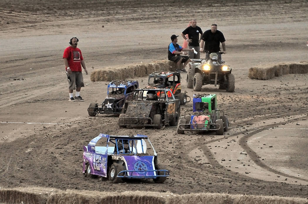 Horace Langford Jr./Pahrump Valley Times Being in the lead means getting your car a lot less muddy on the infield track at Pahrump Valley Speedway during the monthly races of the Southern Nevada M ...