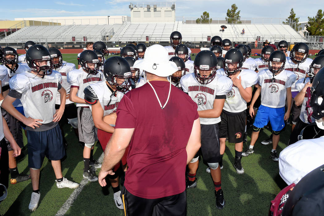 Peter Davis/Special to the Pahrump Valley Times Football coach Joe Clayton addresses his players between drills during practice July 10 at the Pahrump Valley High School football field.