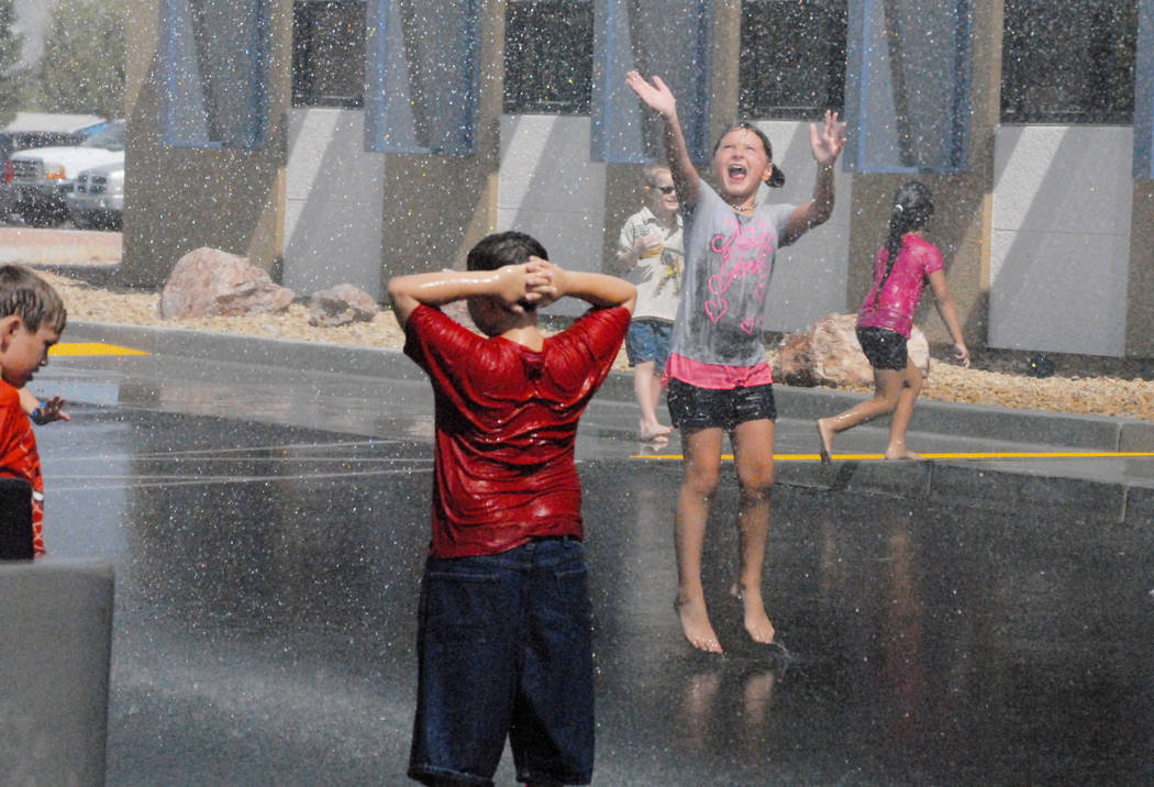 Horace Langford Jr. / Pahrump Valley Times - Several local kids are pictured delighting in the spray while crews from Pahrump Valley Fire and Rescue Services provided a cool-down at a past Back to ...