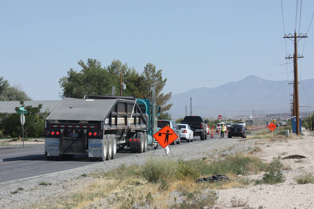 Robin Hebrock/Pahrump Valley Times Taken Monday, July 16 at approximately 9:30 a.m., this photo shows a line of vehicles waiting to proceed through the construction zone on Homestead Road, where o ...
