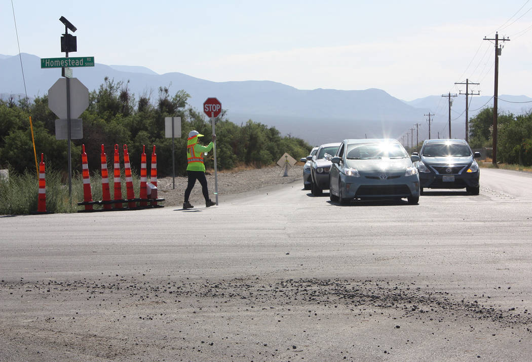 Robin Hebrock/Pahrump Valley Times Other motorists are pictured starting to cross Homestead Road or execute left and right-hand turns while a flagger directs their travel.