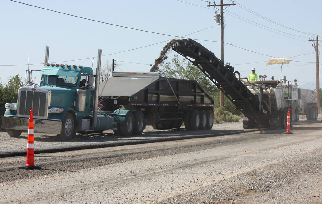 Robin Hebrock/Pahrump Valley Times The first step in the Homestead Road rebuild project is the grinding of the current road surface, a process detailed in this photo.