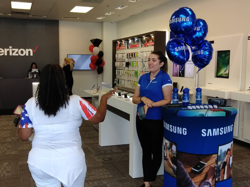 Selwyn Harris/Pahrump Valley Times A Verizon employee greets a customer during Saturday's relocation grand opening. The business moved a few hundred yards south of their former location along Sout ...