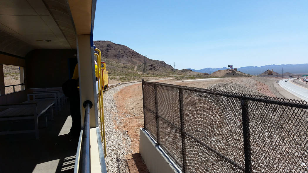 Celia Shortt Goodyear/Boulder City Review A Nevada Southern Railway locomotive travels over the Interstate 11 Railroad Bridge on Friday, April 13, during The Final Spike - A Historic Reconnection ...