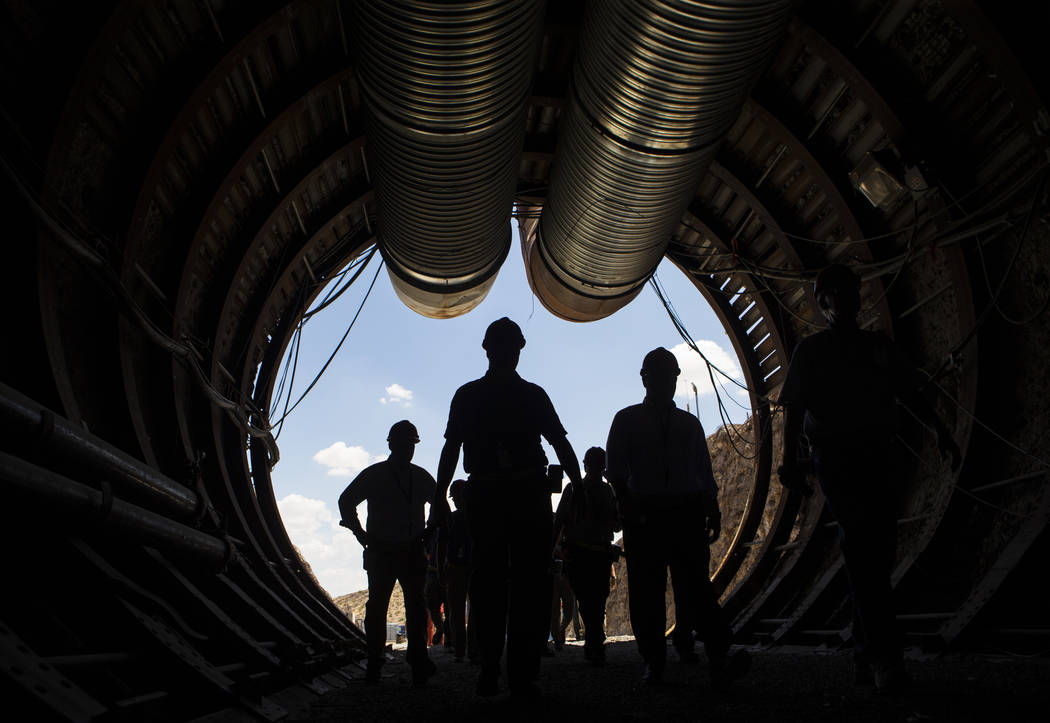 Chase Stevens/Las Vegas Review-Journal Members of a congressional tour make their way through the south portal of Yucca Mountain near Mercury on Saturday, July 14, 2018. A dozen congressman in sup ...