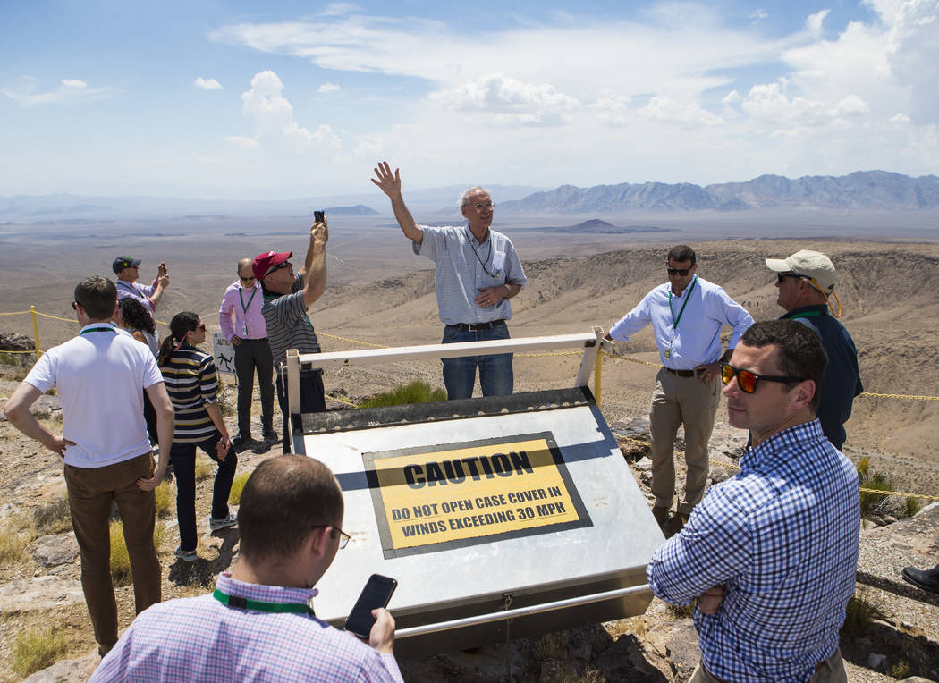 Chase Stevens/Las Vegas Review-Journal Wiilliam Boyle of the Department of Energy's Office of Nuclear Energy, center, speaks at the crest of Yucca Mountain during a congressional tour near Mercury ...