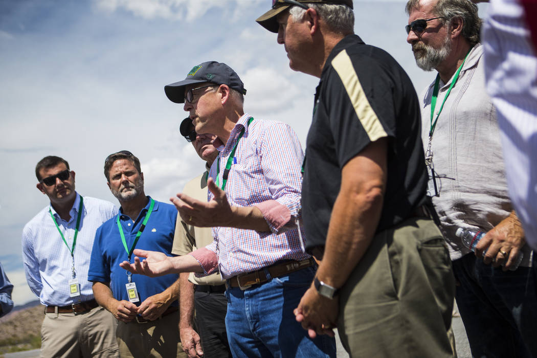 Chase Stevens/Las Vegas Review-Journal U.S. Rep. Greg Walden, R-Ore., center, speaks during a congressional tour of Yucca Mountain near Mercury on Saturday, July 14, 2018. The dozen congressman on ...
