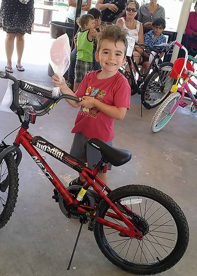 Special to the Pahrump Valley Times A young Pahrump resident is pictured beaming from ear to ear while standing with the new bike he won at last year's Smiles Across Pahrump event.