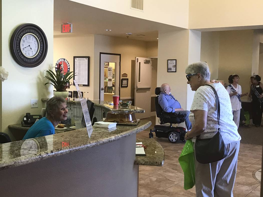 Jeffrey Meehan/Pahrump Valley Times Attendees of an open house event at Inspirations Senior Living in Pahrump check in for the three-hour long gathering on July 19, 2018. Several dozen people show ...