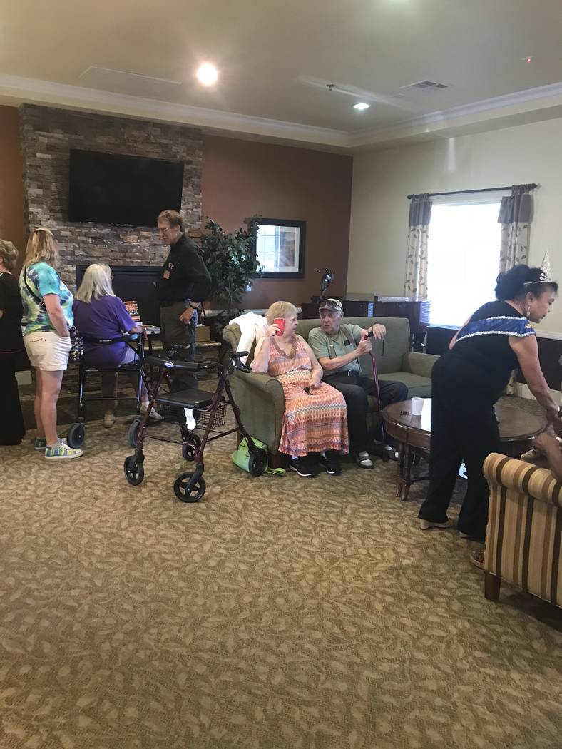 Jeffrey Meehan/Pahrump Valley Times Several people gather near the entrance of Inspirations Senior Living on July 19, 2018. A three-hour long venue at Inspirations drew out dozens of attendees in ...