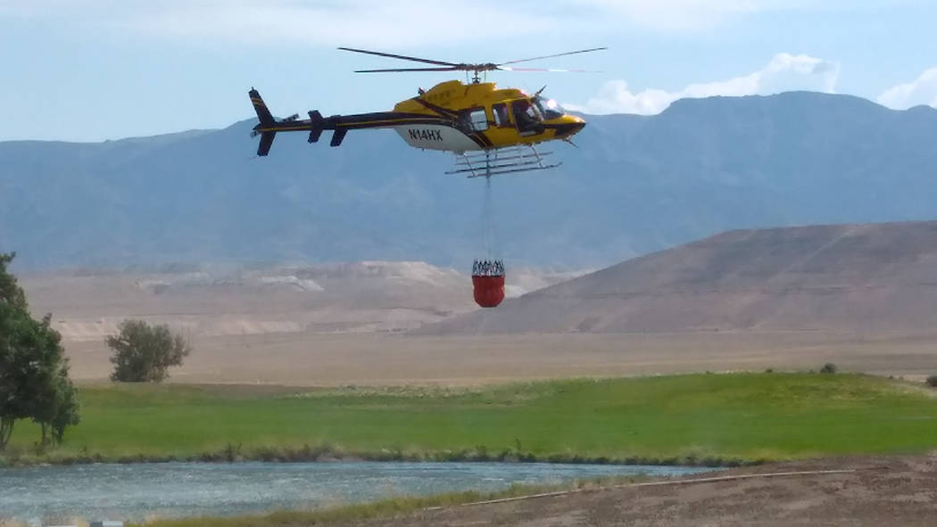 Rob Trelford/Special to the Times-Bonanza A helicopter assisting in the firefight is seen on July 20. Fire resources included 127 firefighters, seven engines, three hand crews, one bulldozer and t ...