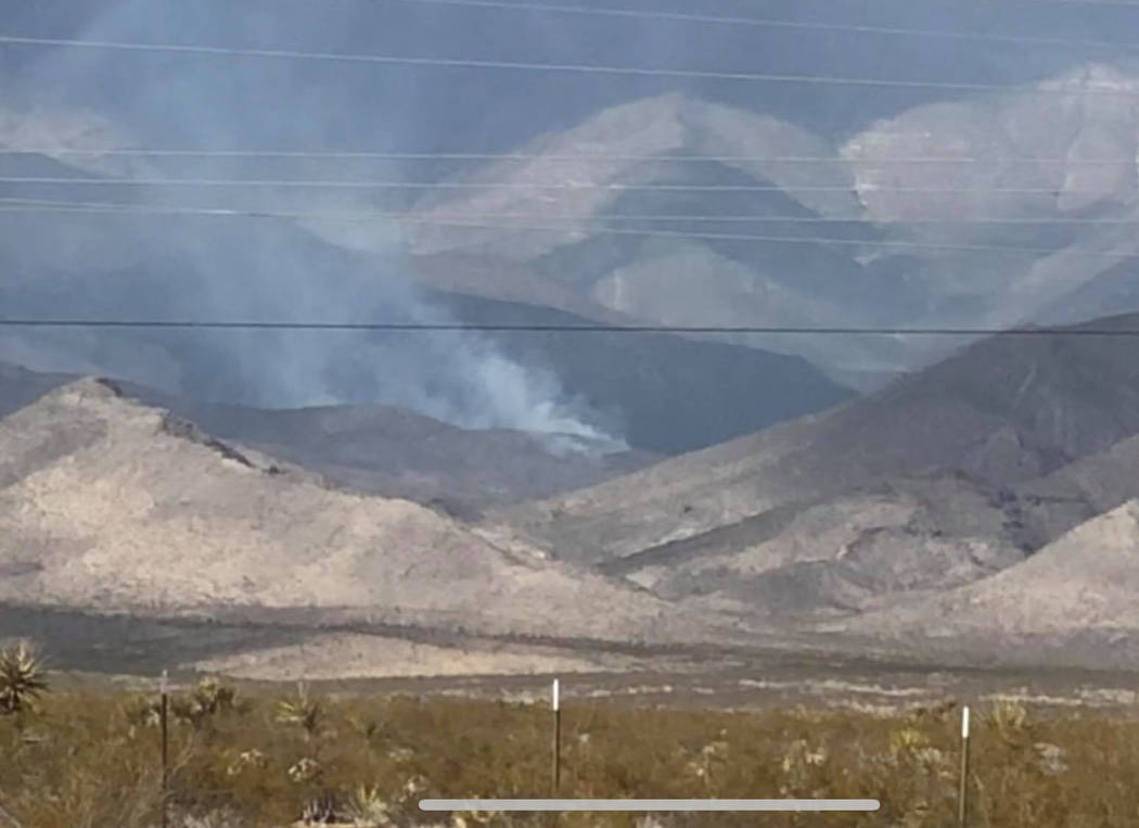 Jessica Reid/Special to the Pahrump Valley Times The 10 acre Crystal Spring Fire, which was 75 percent contained as of Monday afternoon, is burning along the pinyon-juniper woodlands in the Mount ...