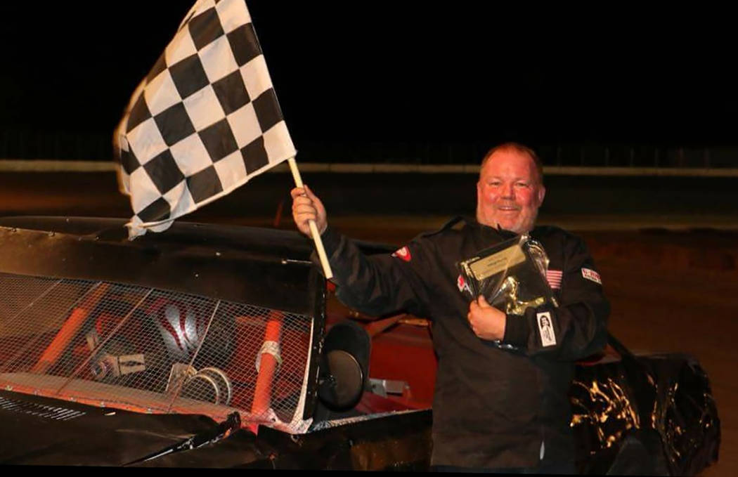Dale Geissler/Pahrump Valley Times Anthony Mann celebrates ending Gary Wyatt's long winning streak in the Bombers division Saturday night at Pahrump Valley Speedway.