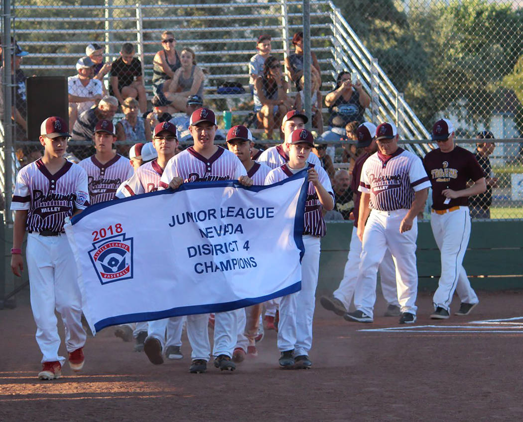Caroline Thacker/Special to the Pahrump Valley Times Players and coaches from the P-Town Little League Junior All-Starts take part in the opening ceremonies for the state tournament at Governors F ...
