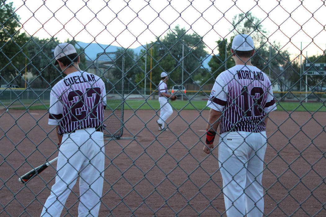 Caroline Thacker/Special to the Pahrump Valley Times Zack Cuellar, left, and Dalton Norland of the P-Town Little League Junior All-Stars wait their turn during batting practice during the state to ...