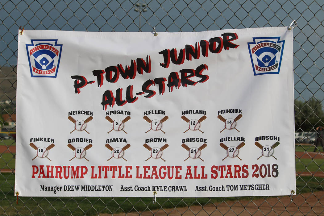 Caroline Thacker/Special to the Pahrump Valley Times P-Town Little League Junior All-Star players and coaches are displayed on a banner during the state tournament in Carson City.