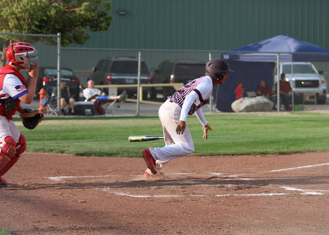 Caroline Thacker/Special to the Pahrump Valley Times P-Town's Jay Amaya breaks for first base after making contact against Boulder City in the state tournament in Carson City.