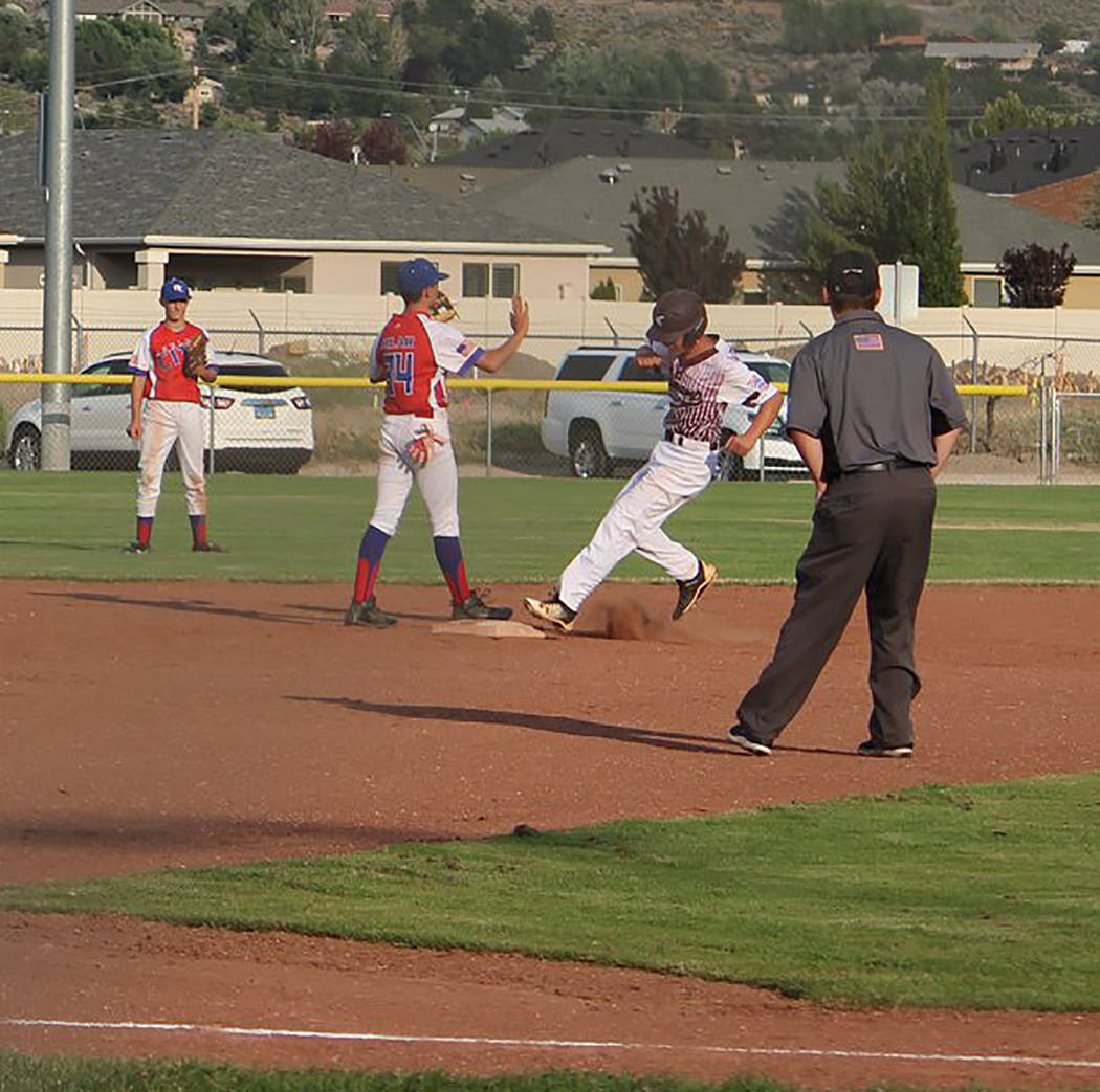 Caroline Thacker/Special to the Pahrump Valley Times Louis Sposato pulls into second base with one of his three doubles against Boulder City during the P-Town Little League Junior All-Stars' 8-7 l ...