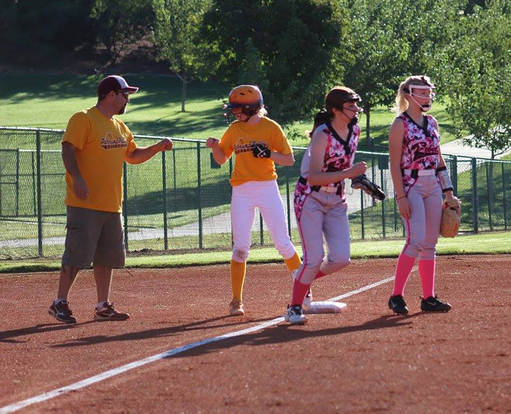 Cassondra Lauver/Special to the Pahrump Valley Times Coach Rich Lauver congratulates Evandy Murphy after she hit a triple against the Southern Utah Rebels in a U16 softball game.