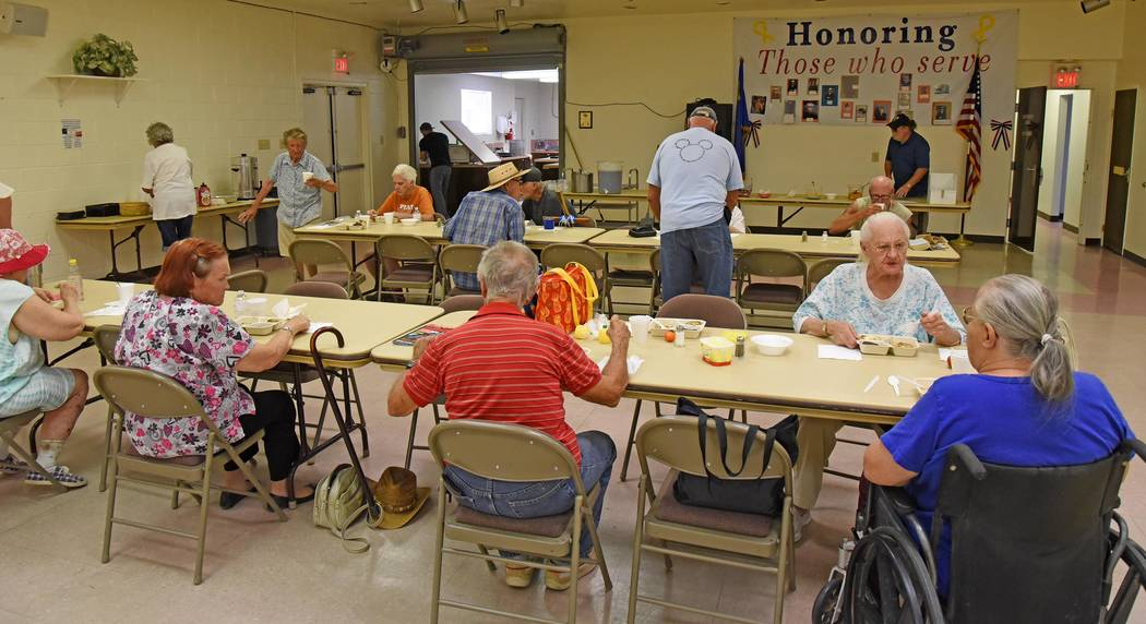 Richard Stephens/Special to the Times-Bonanza Senior citizens in Beatty who normally eat at the senior center eat at the Beatty Community Center while repairs are done on the building, which is cl ...