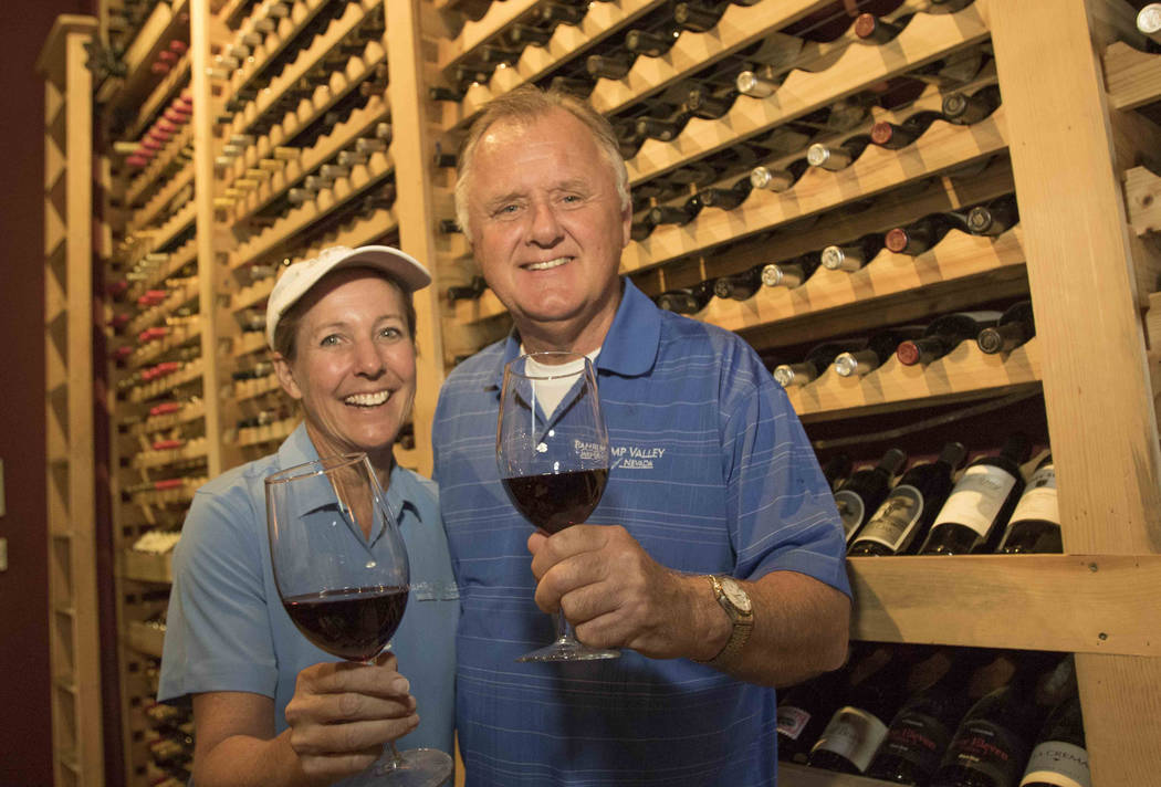 Richard Brian/Las Vegas Review-Journal Winemakers Gretchen and Bill Loken pose in their wine room during a grape harvest at the Pahrump Valley Winery in Pahrump, Nev., Thursday, Aug. 11, 2016.