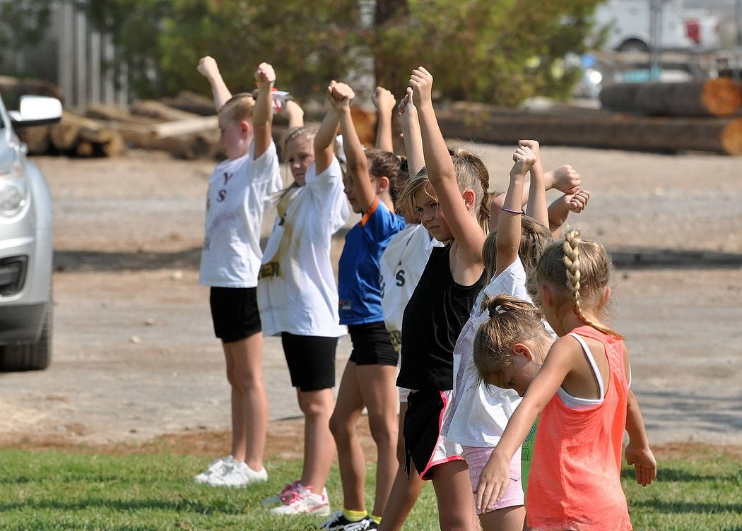 Horace Langford Jr./Pahrump Valley Times Cheerleaders work out at Petrack Park in preparation for the Pahrump Valley Junior Trojans opening game Sept. 1.
