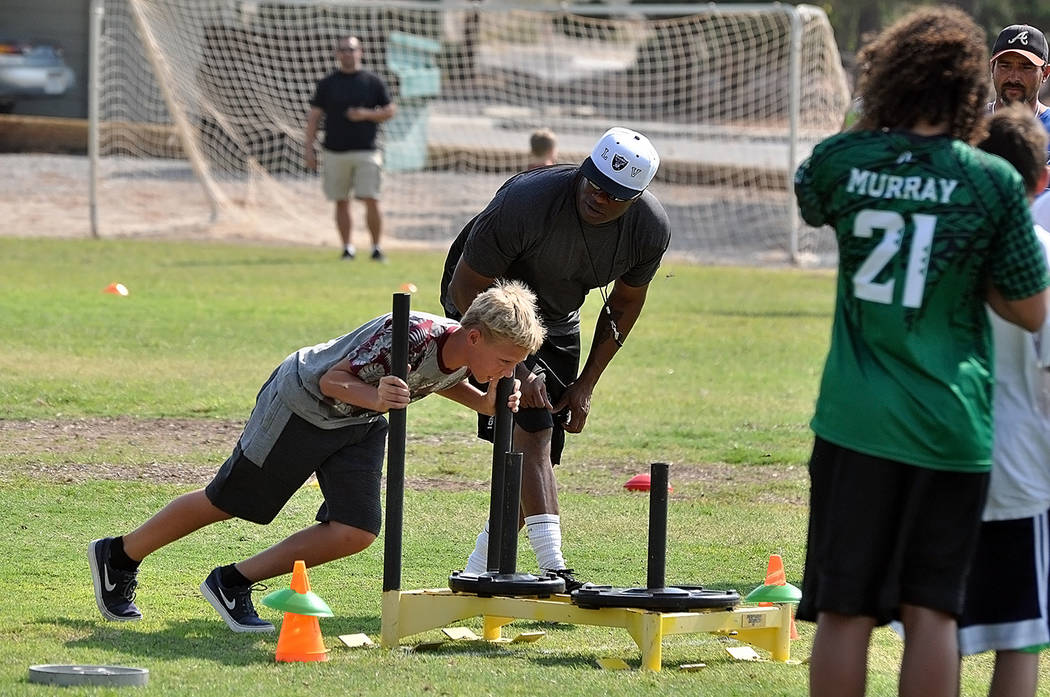 Horace Langford Jr./Pahrump Valley Times Coaches encourage young football players during drills July 28 at Petrack Park during a preseason combine.