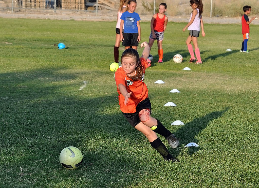 Horace Langford Jr./Pahrump Valley Times Junior Trojans Soccer Club players participate in drills during practice Monday at Petrack Park in Pahrump.