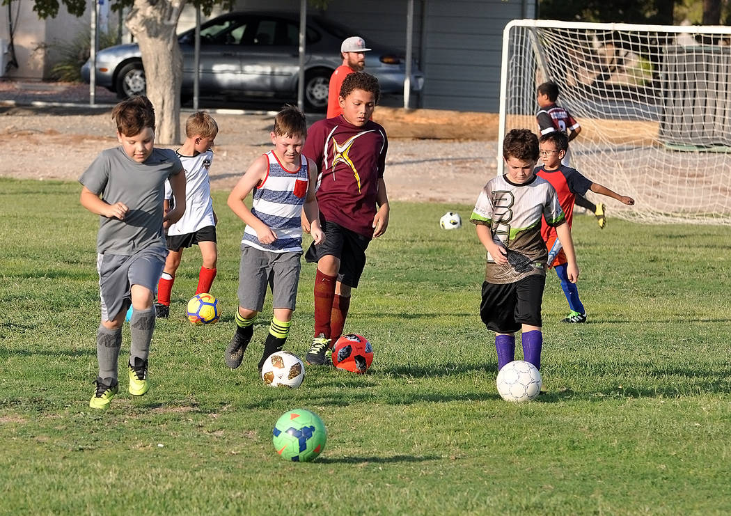 Horace Langford Jr./Pahrump Valley Times Players warm up before the start of Junior Trojans Soccer Club practice Monday at Petrack Park in Pahrump.