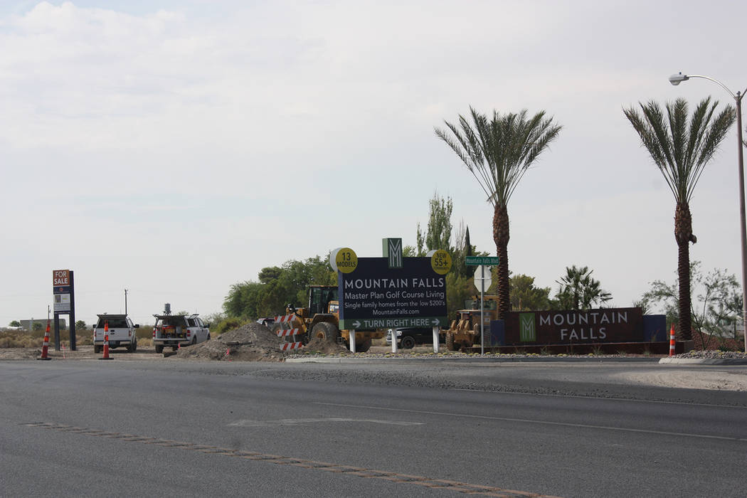 Robin Hebrock/Pahrump Valley Times Work crews continue to improve the entrance to the Mountain Falls area at Highway 160 and Mountain Falls Boulevard.