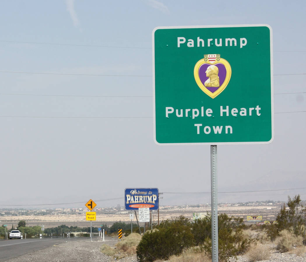 Robin Hebrock/Pahrump Valley Times A newly erected sign now notified drivers entering Pahrump on Highway 160 of the town's status as an official Purple Heart entity. More signs proudly proclaiming ...